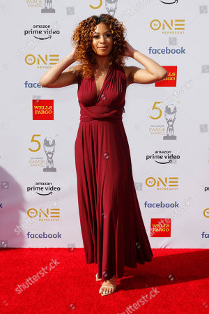 Skye Townsend poses for the photographers upon arrival for the 50th NAACP Image Awards at the Dolby Theatre in Hollywood, California, USA, 30 March 2019 (issued 31 March 2019). The NAACP Image awards honor excellence in television, recording and motion picture categories.