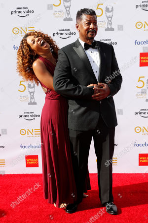 Stock Photo of Skye Townsend (L) and her father US actor Robert Townsend pose for the photographers upon arrival for the 50th NAACP Image Awards at the Dolby Theatre in Hollywood, California, USA, 30 March 2019 (issued 31 March 2019). The NAACP Image awards honor excellence in television, recording and motion picture categories.