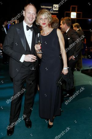 Stock Picture of Johann von Buelow (L) and his wife Katrin von Buelow (R) attends the 'Goldene Kamera' (Golden Camera) 2019 after party at Tempelhof Airport in Berlin, Germany, 30 March 2019.