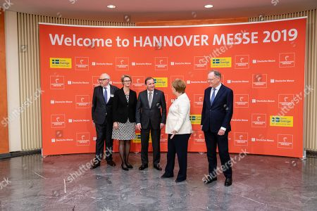(L-R), Michael Ziesemer, president of the Central Electrical Engineering and Electrical Industry Association (ZVEI), German Minister of Education and Research Anja Karliczek, Swedish Prime Minister Stefan Lofven, German Chancellor Angela Merkel and Stephan Weil, premier of the German state Lower Saxony, pose for a photo prior the opening ceremony of the Hannover Industry Fair (Hannover Messe) in Hanover, Germany, 31 March 2019. From 01 April to 05 April, 6,500 exhibitors from 75 countries show their products during one of the World's leading fairs for industrial goods. Main focus of the Hannover Messe 2019 is on Artificial Intelligence and the new mobile standard 5G.