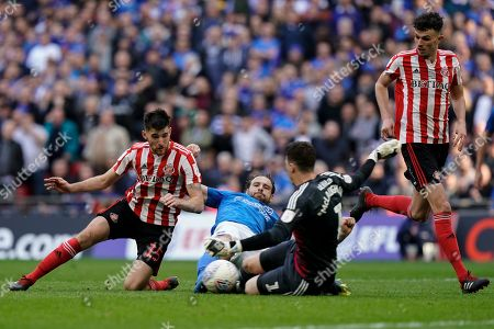 Brett Pitman of Portsmouth slides in as Jon McLaughlin of Sunderland comes to make the save during the EFL Trophy Final match between Portsmouth and Sunderland at Wembley Stadium, London