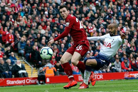 Liverpool defender Andrew Robertson (26) and Tottenham Hotspur midfielder Lucas (27) tangle in the box during the Premier League match between Liverpool and Tottenham Hotspur at Anfield, Liverpool