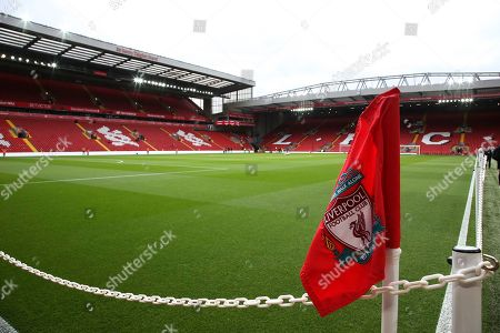 Liverpool FC corner flag with the Sir Kenny Dalglish Stand and the Kop in the background before the Premier League match between Liverpool and Tottenham Hotspur at Anfield, Liverpool