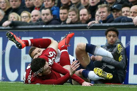 Stock Picture of Liverpool defender Andrew Robertson (26) and Tottenham Hotspur defender Kieran Trippier (2) get in a tangle during the Premier League match between Liverpool and Tottenham Hotspur at Anfield, Liverpool