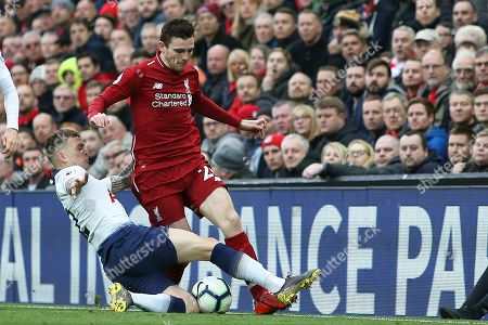 Stock Picture of Tottenham Hotspur defender Kieran Trippier (2)puts the challenge on Liverpool defender Andrew Robertson (26) during the Premier League match between Liverpool and Tottenham Hotspur at Anfield, Liverpool