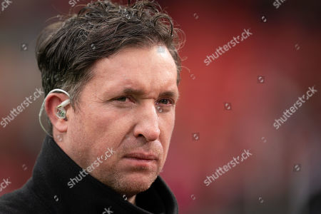 Stock Photo of Robbie Fowler giving an interview before the match