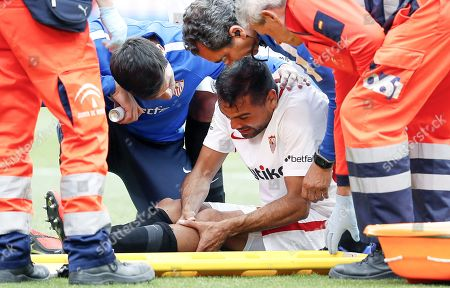 Sevilla's defender Gabriel Mercado (C) receives medical assistance after being injured during the Spanish La Liga soccer match between Sevilla FC and Valencia CF at Ramon Sanchez Pizjuan stadium in Seville, Spain, 31 March 2019.