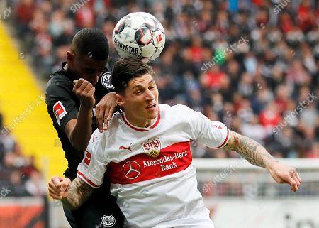 Frankfurt's Gelson Fernandes (L) in action against Stuttgart's Steven Zuber (R) during the German Bundesliga soccer match between Eintracht Frankfurt and VfB Stuttgart in Frankfurt, Germany, 31 March 2019.