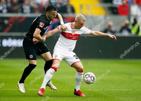 Frankfurt's Filip Kostic (L) in action against Stuttgart's Andreas Beck (R) during the German Bundesliga soccer match between Eintracht Frankfurt and VfB Stuttgart in Frankfurt, Germany, 31 March 2019.