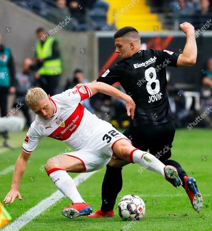Frankfurt's Luka Jovic (R) in action against Stuttgart's Andreas Beck (L) during the German Bundesliga soccer match between Eintracht Frankfurt and VfB Stuttgart in Frankfurt, Germany, 31 March 2019.