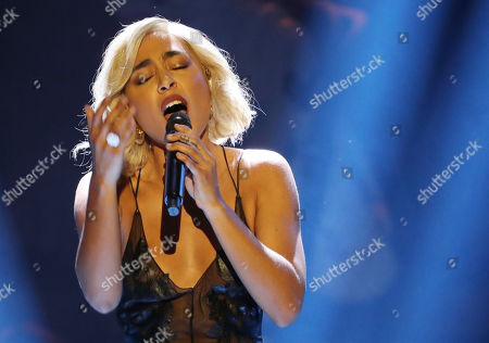 Stock Picture of Swedish singer Loreen performs during the opening ceremony of the Hannover Industry Fair, in Hanover, northern Germany, 31 March 2019. From 01 April to 05 April, 6,500 exhibitors from 75 countries show their products during one of the world's leading fair for industrial goods. Its main focus is on Artificial Intelligence and the new mobile standard 5G.