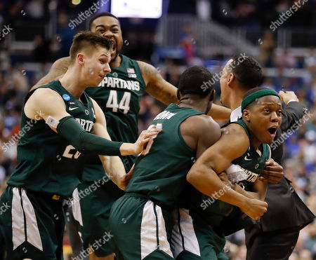 Cassius Winston, Matt McQuaid, Gabe Brown. Michigan State guard Cassius Winston, right, celebrates with teammates Matt McQuaid (20), Nick Ward (44) and Gabe Brown (13) after defeating Duke in an NCAA men's East Regional final college basketball game in Washington
