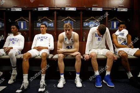 Mike Buckmire, Justin Robinson, Jack White, Antonio Vrankovic, Marques Bolden. Duke guard Mike Buckmire, from left, forward Justin Robinson, forward Jack White, center Antonio Vrankovic and center Marques Bolden sit in the Duke locker room after an NCAA men's East Regional final college basketball game against Michigan State, in Washington. Michigan State won 68-67