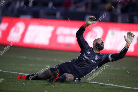 R m. Colorado Rapids goalkeeper Tim Howard (1) misses a shot that goes in for a goal for the Houston Dynamo in the first half of a MLS soccer match, in Commerce City, Colo