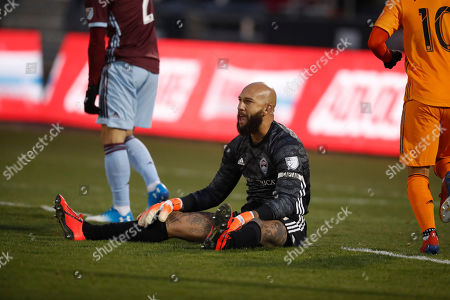 R m. Colorado Rapids goalkeeper Tim Howard (1) reacts after giving up a goal to the Houston Dynamo in the first half of a MLS soccer match, in Commerce City, Colo