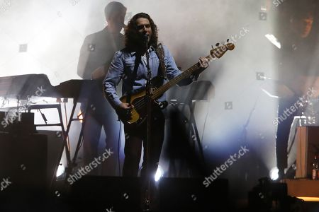 Stock Image of Bass player Nick O'Malley of the British band Arctic Monkeys performs on stage during their concert at the Lollapalooza music festival in Santiago, Chile, 31 March 2019.