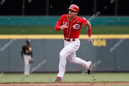 Cincinnati Reds' Derek Dietrich advances to third on a single by Joey Votto off Pittsburgh Pirates starting pitcher Trevor Williams in the sixth inning of a baseball game, in Cincinnati