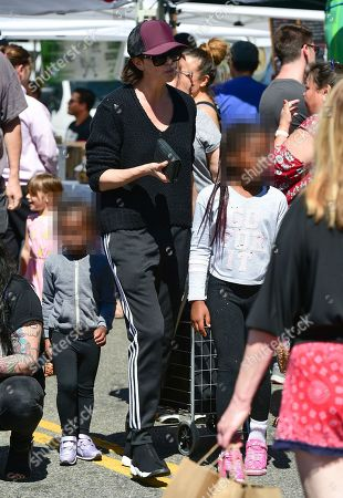 Stock Picture of Charlize Theron, August Theron and Jackson Theron