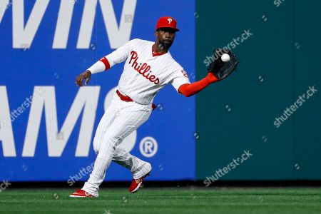 Philadelphia Phillies left fielder Andrew McCutchen fields a single by Atlanta Braves' Josh Donaldson during the third inning of a baseball game, in Philadelphia
