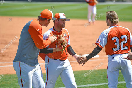 Tanner Hall, Nick Spear. Mercer pitcher Tanner Hall, center, is encouraged by Nick Spear, right, and a Mercer coach after a strong inning during an NCAA college baseball game against Wofford, in Spartanburg, S.C