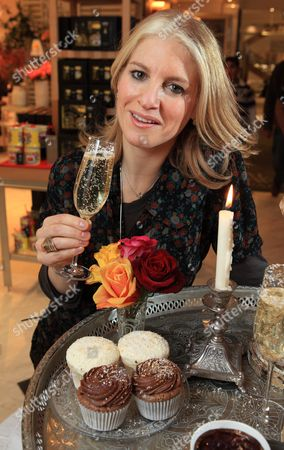 Laura Santtini with gold and silver sprinkled champagne