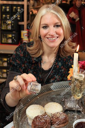 Laura Santtini using a shaker to sprinkle food with gold and silver flakes.