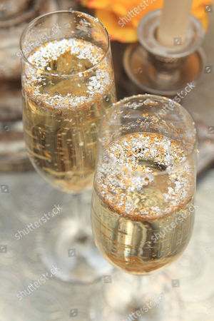 Stock Picture of Gold and silver sprinkled champagne