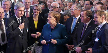Stock Photo of The German Chancellor Angela Merkel (C) and Swedish Prime Minister Stefan Loevfen (2-R) with the state governor of Lower Saxony, Stephan Weil (3-R) at the Siemens booth during their opening tour at the Hannover Industry Fair (Hannover Messe) in Hanover, Germany, 01 April 2019. From 01 April to 05 April, 6,500 exhibitors from 75 countries show their products during one of the World's leading fairs for industrial goods. The main focus of the Hannover Messe 2019 is on Artificial Intelligence and the new mobile standard 5G.