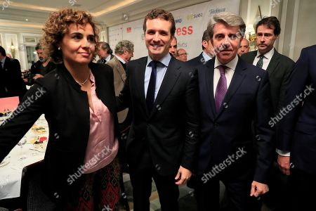 Leader of Spanish People's Party (PP) Pablo Casado (C) poses next to Madrid's regional President Angel Garrido (R), and the party's number one candidate for the European Elections Dolors Monserrat (L) during a breakfast briefing in a hotel in Madrid, Spain, 01 April 2019. Spain will be holding general elections 28 April 2019.