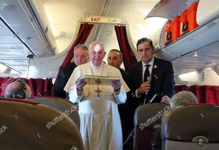 Pope Francis offers a cake on the occasion of the birthday of two journalists Philip Pullella and Gerard O'Connell