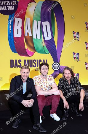 The members of the pop band Take That, Gary Barlow (L), Mark Owen (R) and Howard Donald pose for pictures during their visit to the rehearsals of their musical in Berlin, Germany, 01 April 2019. The event THE BAND is a jukebox musical with music and lyrics by Take That and a book by Tim Firth. It tells the story of five teenagers who were fans of Take That and, 25 years later, the women reunite to fulfill their dream of seeing the band perform.