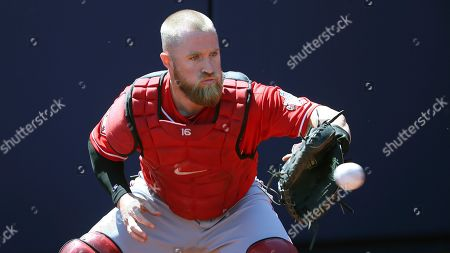 Stock Picture of Cincinnati Reds catcher Tucker Barnhart warms up prior to a spring training baseball game against the Milwaukee Brewers, in Phoenix