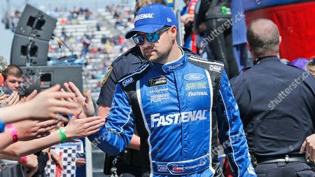 NASCAR Cup Series driver Ricky Stenhouse Jr. (17) greets fans during driver introductions prior to the NASCAR Cup Series auto race at the Martinsville Speedway in Martinsville, Va
