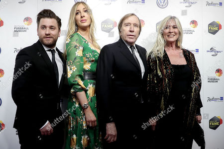 German former soccer player Guenter Netzer (2-R), his wife Elvira (R) and their daughter Alana (2-L) with her boyfriend Sebastian Buergin (L) arrive for the opening gala of the 'Hall Of Fame' of German football in Dortmund, Germany, 01 April 2019. The Hall Of Fame will be part of the permanent exhibition in the German Football Museum, where players and coaches of men's and women's soccer of German origin will be honored for their outstanding achievements in shaping German soccer from 1900 until today.