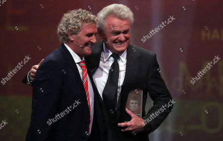 Belgian former soccer goalkeeper Jean-Marie Pfaff (L) honours former German soccer goalkeeper Sepp Maier as best German goalkeeper of the century during the opening gala of the 'Hall Of Fame' of German football in Dortmund, Germany, 01 April 2019.. The Hall Of Fame will be part of the permanent exhibition in the German Football Museum, where players and coaches of men's and women's soccer of German origin will be honored for their outstanding achievements in shaping German soccer from 1900 until today.