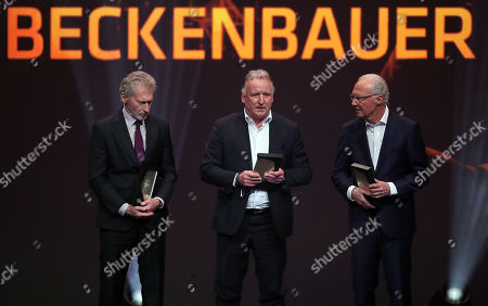 (L-R) German former soccer player Paul Breitner, German former soccer player Andreas Brehme and German former soccer player Franz Beckenbauer are admitted to the 'Hall Of Fame' as the best defensive players during the opening gala of the 'Hall Of Fame' of German football in Dortmund, Germany, 01 April 2019.. The Hall Of Fame will be part of the permanent exhibition in the German Football Museum, where players and coaches of men's and women's soccer of German origin will be honored for their outstanding achievements in shaping German soccer from 1900 until today.