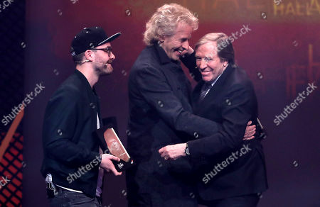 German television host Thomas Gottschalk (C)honored German former soccer player Guenter Netzer (R) during the opening gala of the 'Hall Of Fame' of German football in Dortmund, Germany, 01 April 2019. The Hall Of Fame will be part of the permanent exhibition in the German Football Museum, where players and coaches of men's and women's soccer of German origin will be honored for their outstanding achievements in shaping German soccer from 1900 until today.