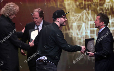 German musician Mark Foster (L) honored German former soccer player Lothar Matthaeus (R) during the opening gala of the 'Hall Of Fame' of German football in Dortmund, Germany, 01 April 2019. The Hall Of Fame will be part of the permanent exhibition in the German Football Museum, where players and coaches of men's and women's soccer of German origin will be honored for their outstanding achievements in shaping German soccer from 1900 until today.