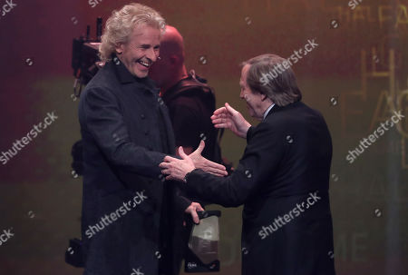 German television host Thomas Gottschalk honored German former soccer player Guenter Netzer during the opening gala of the 'Hall Of Fame' of German football in Dortmund, Germany, 01 April 2019. The Hall Of Fame will be part of the permanent exhibition in the German Football Museum, where players and coaches of men's and women's soccer of German origin will be honored for their outstanding achievements in shaping German soccer from 1900 until today.