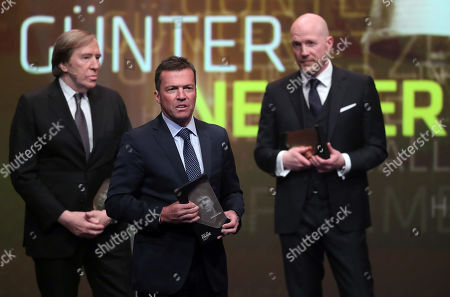 (L-R) German former soccer player Guenter Netzer, German former soccer player Lothar Matthaeus and German former soccer player Matthias Sammer are admitted to the 'Hall Of Fame' as the best middle field players during the opening gala of the 'Hall Of Fame' of German football in Dortmund, Germany, 01 April 2019. The Hall Of Fame will be part of the permanent exhibition in the German Football Museum, where players and coaches of men's and women's soccer of German origin will be honored for their outstanding achievements in shaping German soccer from 1900 until today.