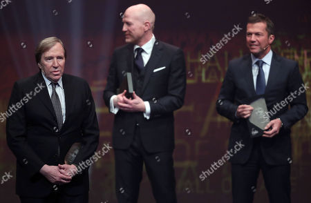 (L-R) German former soccer player Guenter Netzer, German former soccer player Matthias Sammer and German former soccer player Lothar Matthaeus are admitted to the 'Hall Of Fame' as the best middle field players during the opening gala of the 'Hall Of Fame' of German football in Dortmund, Germany, 01 April 2019. The Hall Of Fame will be part of the permanent exhibition in the German Football Museum, where players and coaches of men's and women's soccer of German origin will be honored for their outstanding achievements in shaping German soccer from 1900 until today.