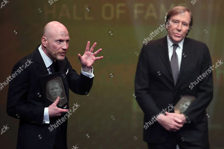 (L-R) German former soccer player Matthias Sammer and German former soccer player Guenter Netzer are admitted to the 'Hall Of Fame' as the best middle field players during the opening gala of the 'Hall Of Fame' of German football in Dortmund, Germany, 01 April 2019. The Hall Of Fame will be part of the permanent exhibition in the German Football Museum, where players and coaches of men's and women's soccer of German origin will be honored for their outstanding achievements in shaping German soccer from 1900 until today.