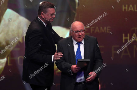 Germany's DFB-President Reinhard Grindel (L) honours German former soccer player Uwe Seeler as best striker during the opening gala of the 'Hall Of Fame' of German football in Dortmund, Germany, 01 April 2019. The Hall Of Fame will be part of the permanent exhibition in the German Football Museum, where players and coaches of men's and women's soccer of German origin will be honored for their outstanding achievements in shaping German soccer from 1900 until today.