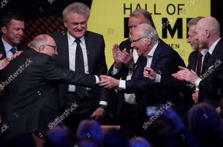 German former soccer player Franz Beckenbauer (C) congratulates German former soccer player Uwe Seeler (L) during the opening gala of the 'Hall Of Fame' of German football in Dortmund, Germany, 01 April 2019. The Hall Of Fame will be part of the permanent exhibition in the German Football Museum, where players and coaches of men's and women's soccer of German origin will be honored for their outstanding achievements in shaping German soccer from 1900 until today.