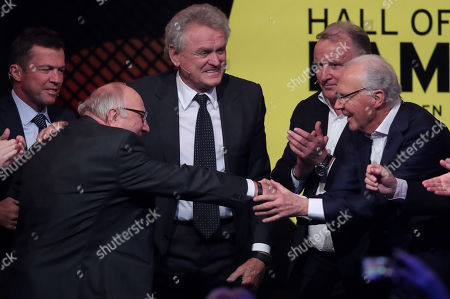 German former soccer player Franz Beckenbauer (R) congratulates German former soccer player Uwe Seeler (L) during the opening gala of the 'Hall Of Fame' of German football in Dortmund, Germany, 01 April 2019. The Hall Of Fame will be part of the permanent exhibition in the German Football Museum, where players and coaches of men's and women's soccer of German origin will be honored for their outstanding achievements in shaping German soccer from 1900 until today.