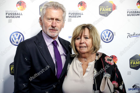 German former soccer player Paul Breitner (L) and his wife arrive for the opening gala of the 'Hall Of Fame' of German football in Dortmund, Germany, 01 April 2019. The Hall Of Fame will be part of the permanent exhibition in the German Football Museum, where players and coaches of men's and women's soccer of German origin will be honored for their outstanding achievements in shaping German soccer from 1900 until today.