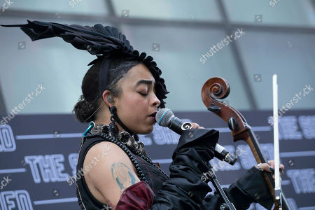 Cellist Kelsey Lu performs at the dedication ceremony for The Shed, a performing arts center at Hudson Yards, in New York. The Shed opens to the public on Friday