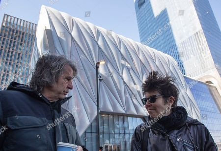 Architects David Rockwell, left, and Elizabeth Diller discuss their work on The Shed, background, before the dedication of the performing arts center, in New York. The Shed opens to the public on Friday