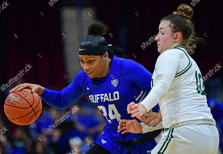 Cierra Dillard, Dominique Doseck. Buffalo guard Cierra Dillard drives on Ohio guard Dominique Doseck during the first half of an NCAA college basketball championship game of the Mid-American Conference women's tournament, in Cleveland. Buffalo won 77-61
