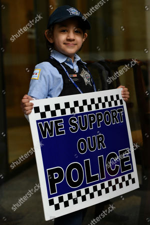 "Five year-old Kareem Ghanimah, the son of a Chicago Police officer, shows his support for the Chicago Police Department during a protest over Cook County State's Attorney Kim Foxx's office's decision to drop all charges against ""Empire"" actor Jussie Smollett, in Chicago"